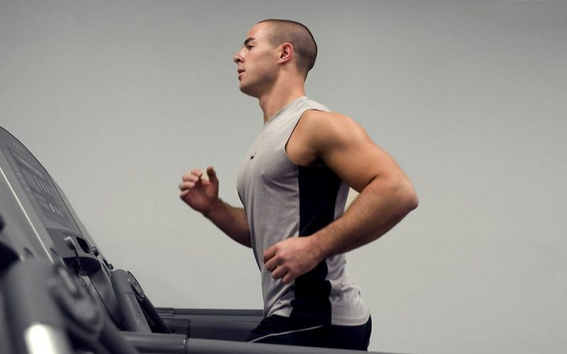 15397-a-healthy-young-man-running-on-a-treadmill-in-a-gym-pv